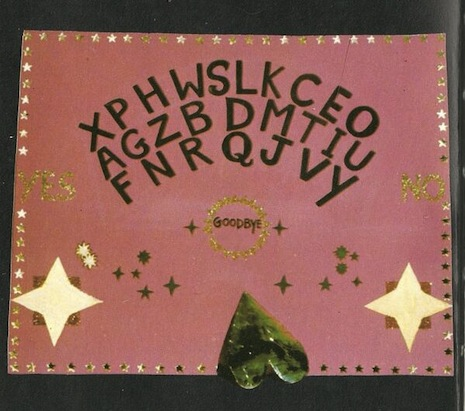 A rare color plate from the book—a homemade ouija board