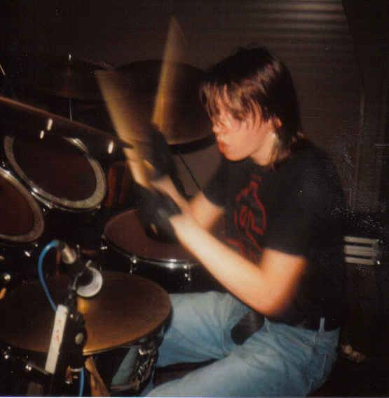 Chris drumming with Oi Polloi in 1987
