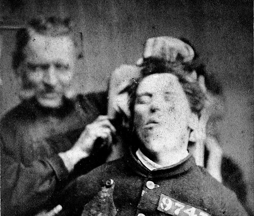 L0019072 West Riding Lunatic Asylum: man restrained by warders; 1869