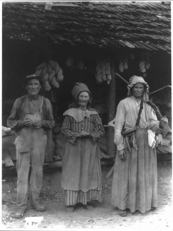 The Faust family, Anderson County, E. Tenn. [Mountain man and 2 women in front of house] Date Created/Published: c1910.