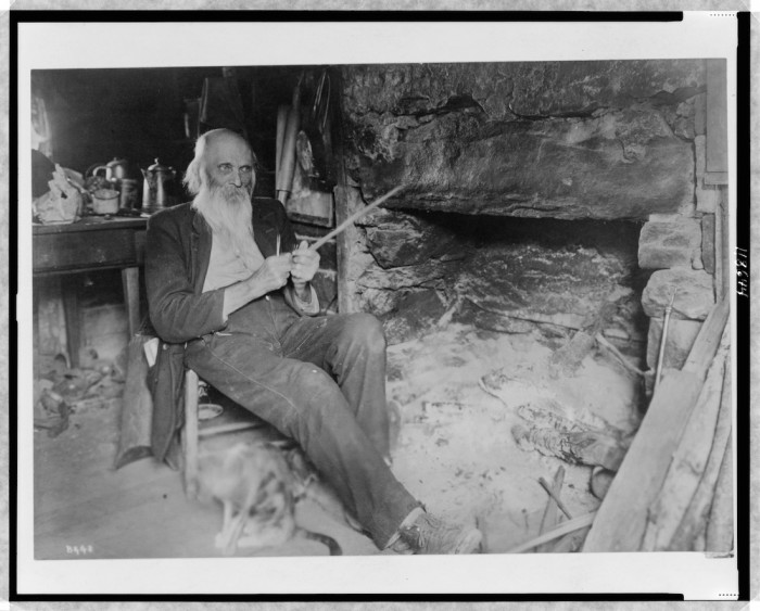 Mountaineer whittling Creator(s): Barnhill, Wm. A. , photographer Date Created/Published: c1920.