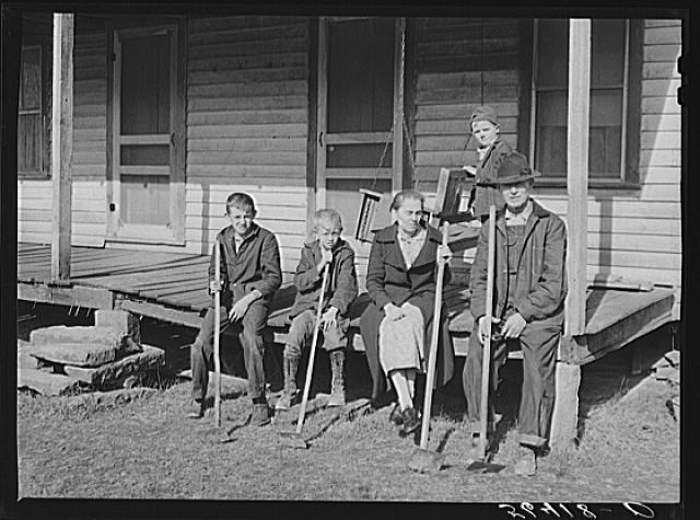 "Dutton (""Dut"") Calleb and his family with their homemade hoes on the porch of their home. Southern Appalachian Project near Barbourville, Knox County, Kentucky Creator(s): Wolcott, Marion Post, 1910-1990, photographer Date Created/Published: 1940 Nov."