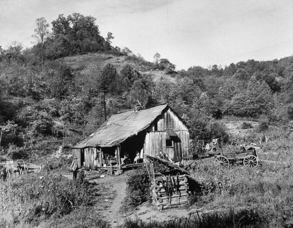 Small coal mining town in impoverished Appalachia, seven family members living in small shack. 1953
