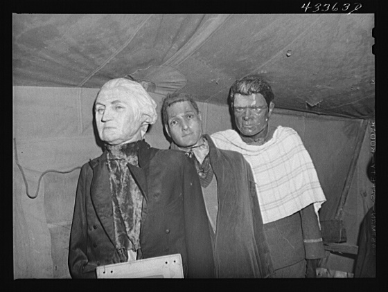 "Effigies of Washington, Joe Louis and some criminal in a travelling sideshow ""crime museum"". Washington and Joe Louis are examples of ""what you may become if you go straight"". Near Fort Bragg, North Carolina Creator(s): Delano, Jack, photographer Date Created/Published: 1941 Mar."