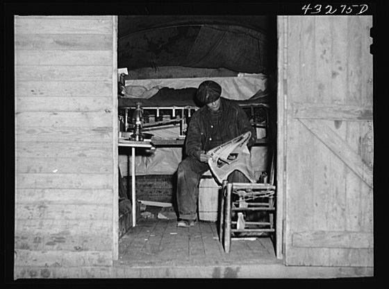 This man is a carpenter at Fort Bragg, North Carolina. This converted truck is his home. The interior of his truck was more roomy than most of the cabins that had been built at the camp where he was staying. At a settlement near Silver Lake, North Carolina (about ten miles out of Fayetteville, N.C.) Creator(s): Delano, Jack, photographer Date Created/Published: 1941 Mar.