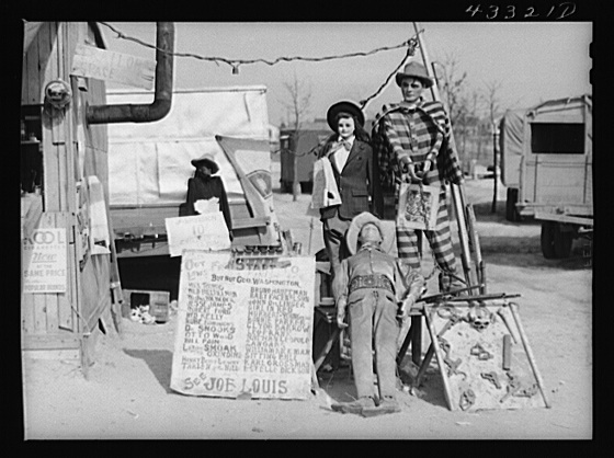 "A traveling side-show. ""Crime Museum,"" consisting of a dilapidated effigies of famous criminals run by an old, shellshocked World War veteran. Near Silver Lake, North Carolina Creator(s): Delano, Jack, photographer Date Created/Published: 1941 Mar."