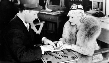 1936: Actors Brian Donlevy and Claire Trevor try out a Ouija board while on break from filming Human Cargo. | (AP Photo) found at http://theweek.com/articles/451347/secret-ouija-board
