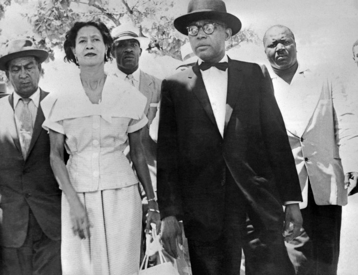 François Duvalier is shown with his wife Simone after they voted in Haiti's presidential election, September 1957, in which Duvalier was a leading candidate. The men in background are Duvalier's bodyguards.