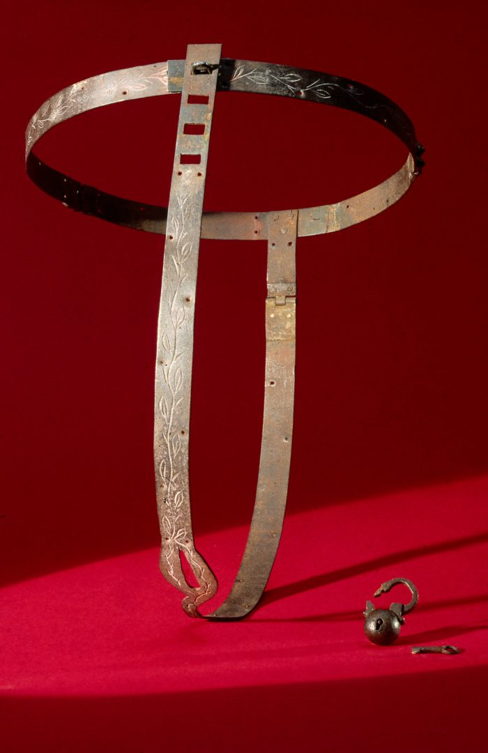 UNITED KINGDOM - NOVEMBER 22:  Chastity belts originated in the 15th century. They were devices designed to prevent the female wearer from having sexual intercourse, and incorporated openings to facilitate urination and defecation. They were locked to prevent their removal. Front view with padlock lying next to the belt.  (Photo by SSPL/Getty Images)