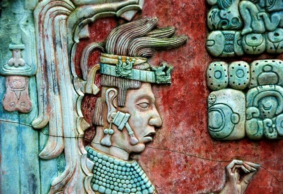 Lord K'inich Janaab' Pakal seen wearing jade ear spools on this base relief at Palenque.