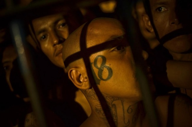 Members of a gang known as Mara 18 crowd into cells at the Izalco jail in Sonsonate, El Salvador.