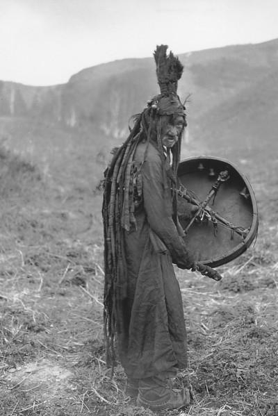 A Mongolian shaman holding a drum.