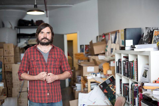 Ian and a lot of books at the Bazillion Points HQ in New York (photo by Jimmy Hubbard)