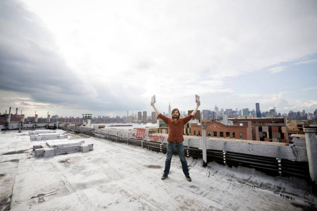 Ian petitioning the empty sky of NY with some nice books (photo by Jimmy Hubbard)