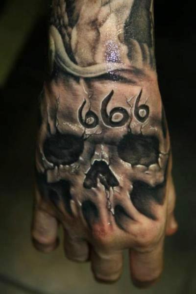 1-666-skull-hand-tattoo