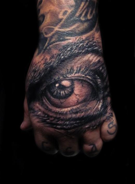 Hand Eye Symbol Tattoo Eye-hand-tattoo-trend-520x706