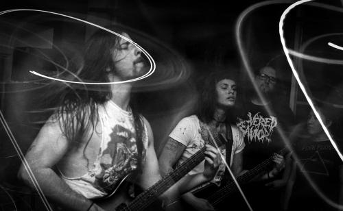 Cartilage performing live, guitarists Teresa and Michael shown