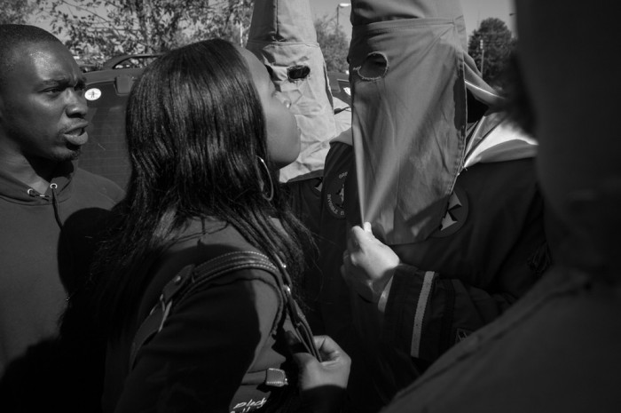A confrontation immediately following a rally hosted by The Mississippi White Knights of the Ku Klux Klan at the Lee county courthouse in Tupelo, Mississippi on Saturday, October 20th, 2007. The protest was against illegal immigration and local sex offenders, and supported putting prayers back in school. The rally included several Klan groups, including the Brotherhood of the Klans, Georgia Knightriders, Bayou Knights, MKA and the International Knights. The last time the Klan made any major appearance in Tupelo was in the 1970's. The Klan marched down Main Street with the United States National Guard protecting citizens on either side.