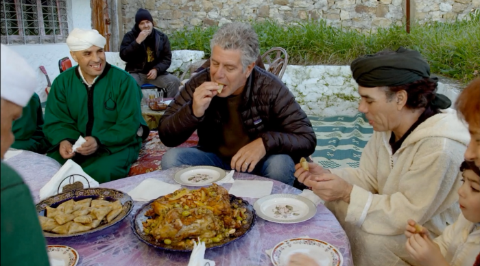 Chef Bourdain eating with his hosts during an episode of Parts Unknown, screenshot by the author.